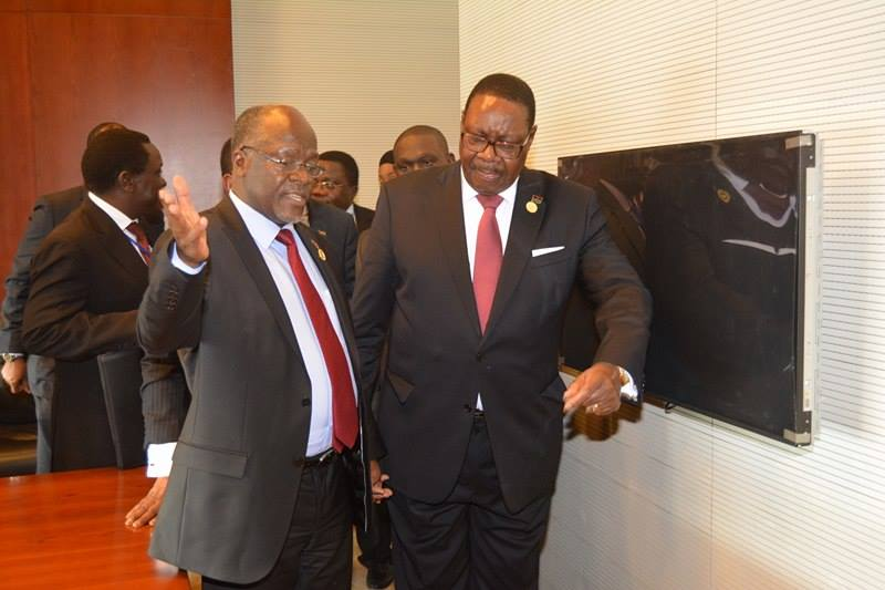 Malawi and Tanzania Presidents sharing notes at AU